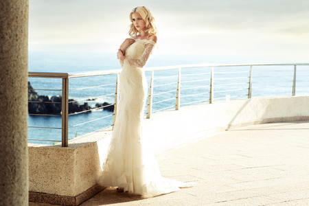 Calm blond bride waiting for her beloved husband