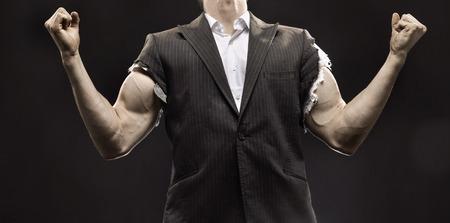life success: Muscular businessman achieving his life success