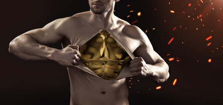 machine man: Muscular mannequin made of gold Stock Photo