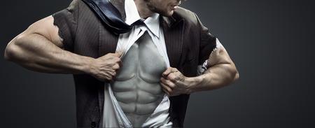 fitnes: Conceptueel beeld van uitgeput gespierde zakenman Stockfoto