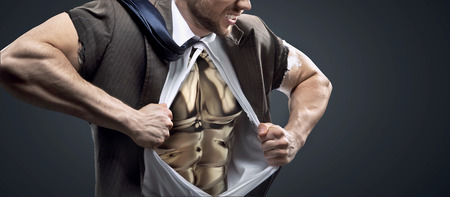 Conceptual picture of a man with glossy golden chest photo