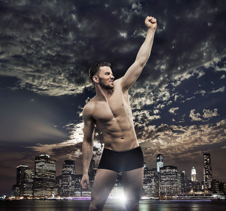 muscle guy: Successul man over the night night background Stock Photo