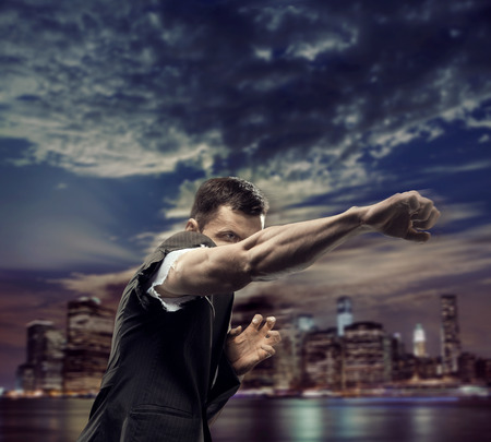 Successful man over the town background photo