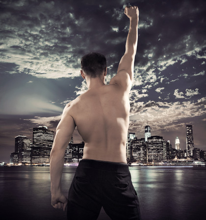 Fit young athlete over the city background photo
