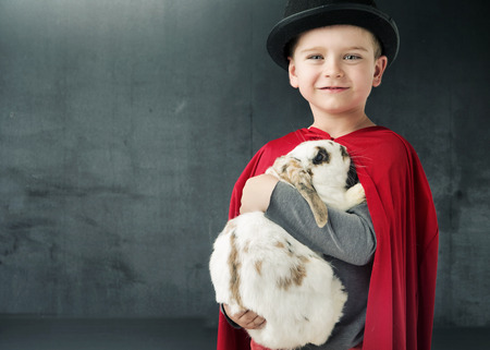 illusionist: Little illusionist holding a magic bunny