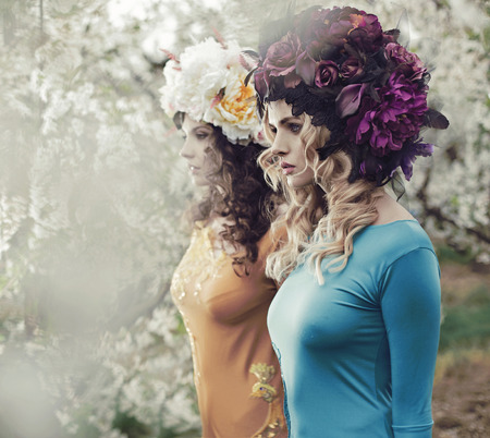 nymphs: Beautiful forest nymphs walking in the colorful orchard Stock Photo