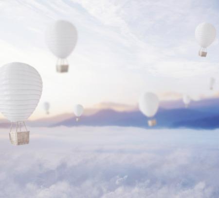 dreamy: Defocused balloons over blue dreamy sky Stock Photo