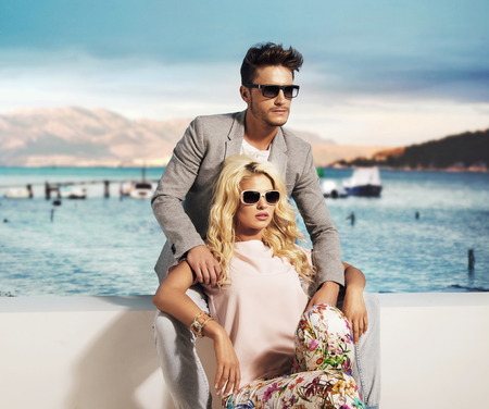 fashion model: Smart couple relaxing in the exotic place Stock Photo