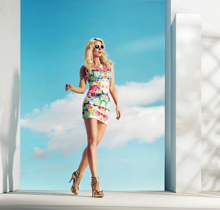 blonde girls: Sensual lady wearinf flowery pattern dress Stock Photo