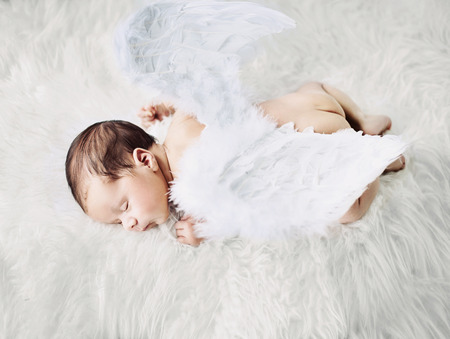 Cute little angel during a short nap Stock Photo
