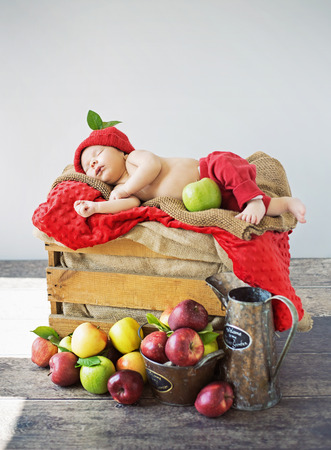 coffer: Cute toddler sleeping on a coffer of apples