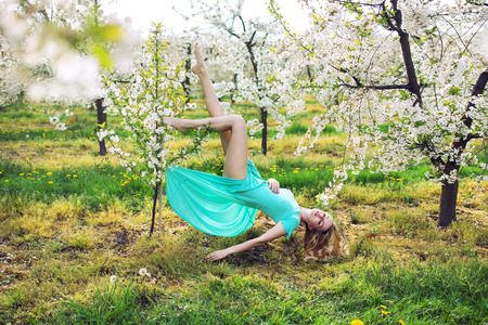 Conceptual picture of a lady levitating in the garden photo