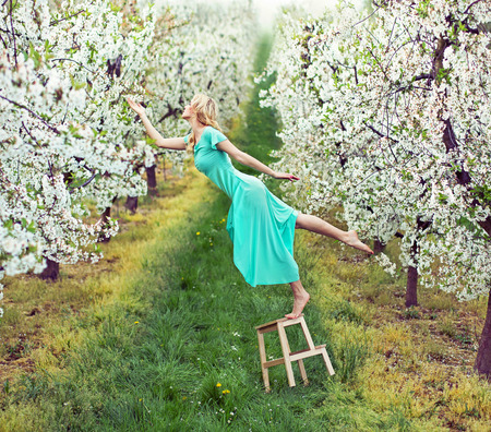 fragrant: Beautiful lady in the colorful orchard Stock Photo
