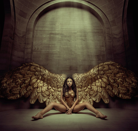 angel girl: Alluring gold angel in the dark hall