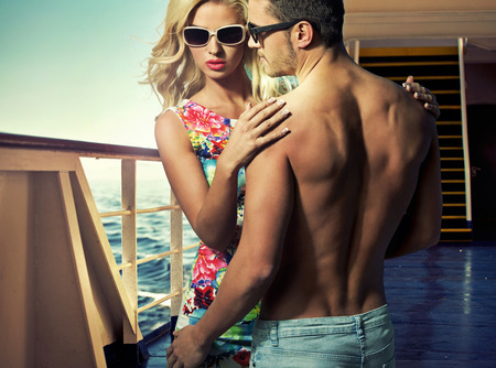 male fashion: Attractive young couple on the luxury ferry