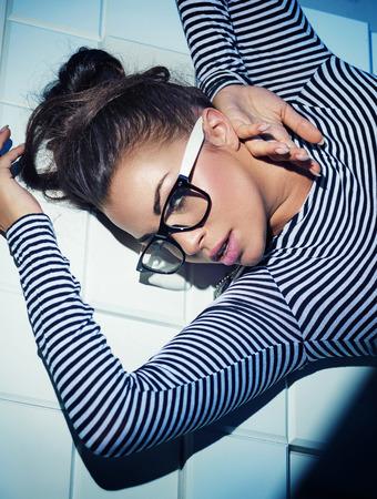 glasses model: Pretty brunette lady with trendy glasses