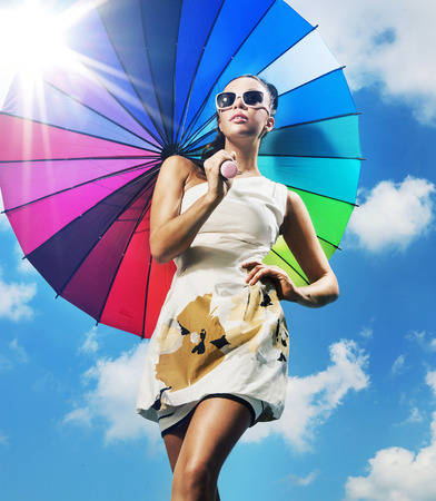 Fashionable photo of a young lady with a colorful umbrella