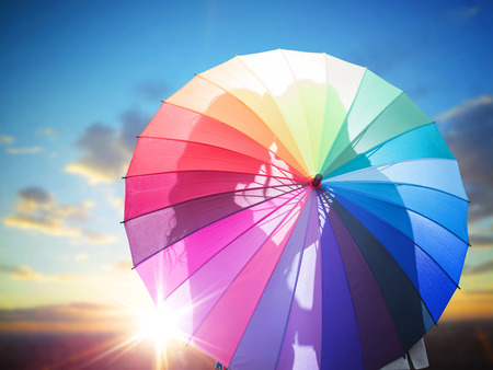 Romantic couple behind the colorful umbrella 스톡 콘텐츠