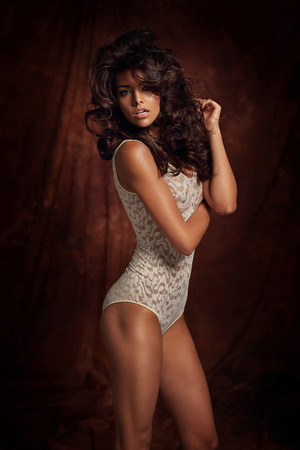 Tawny lady wearing bright lingerie photo