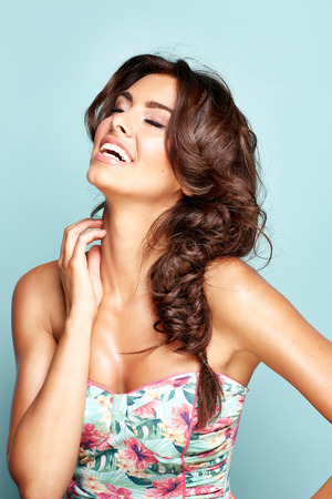 Portrait of a smilling brunette woman Stock Photo