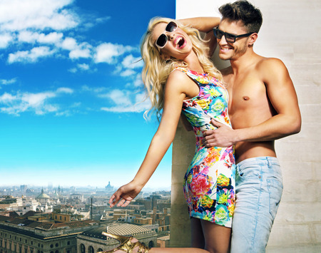 couple outdoor: Young couple hugging over the city panorama Stock Photo
