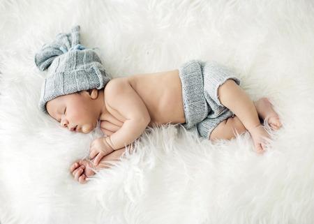 white blanket: Newborn child sleeping on the white blanket