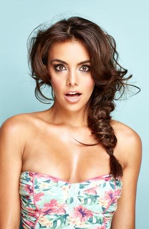 Portrait of a surprised brunette lady photo
