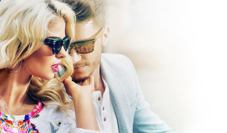 sunglass: Young cheerful couple taking the sunbath Stock Photo
