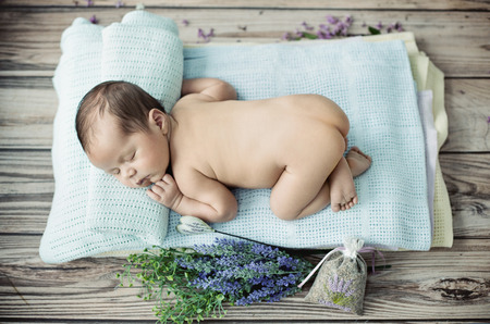 the newborn: Cute little kid sleeping on the blanket