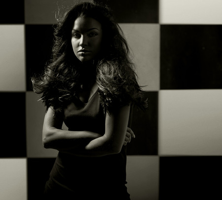 sensual girl: Alluring lady over the chessboard background