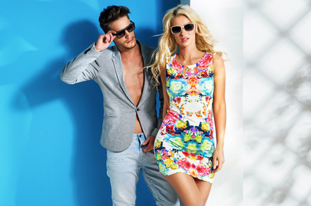 fashion sunglasses: Glamour couple wearing trendy summer clothes