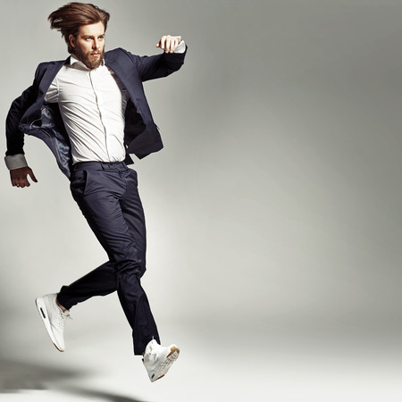 celebrating: Young energetic guy wearing suit