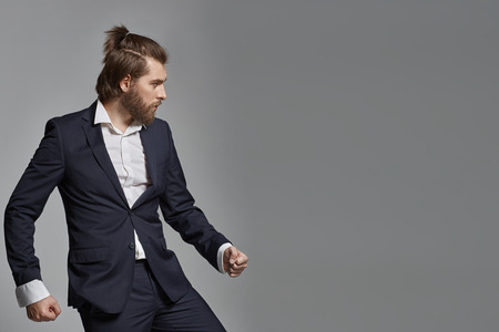 Stylish man with beard wearing suit