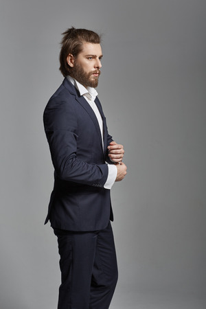 men in suit: Portrait of a handsome guy wearing suit Stock Photo