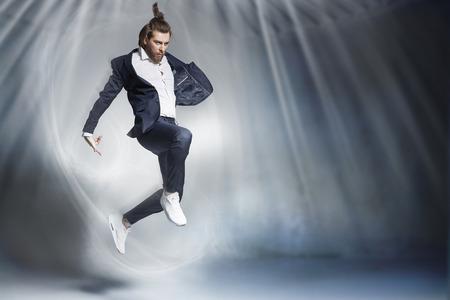 businessman jumping: Handsome jumping businessman wearing stylish stuff