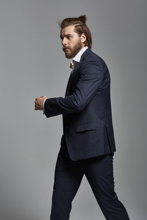 beau mec: Serious handsome guy with a dense beard