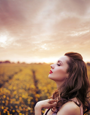 red hair girl: Beautiful woman on the summer flower meadow