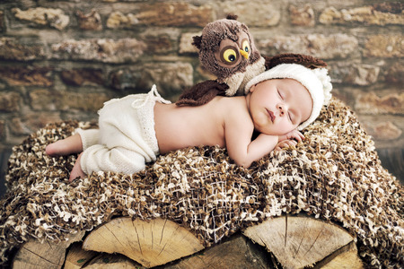 wooden bed: Newborn kid sleeping on the wooden bed