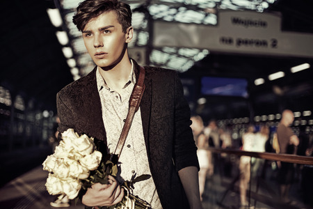 young man portrait: Portrait of the elegant young man with flowers