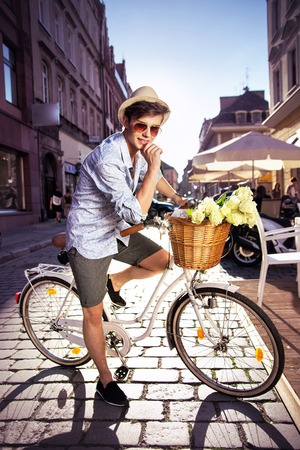flowers boy: Smart guy riding a retro bicycle