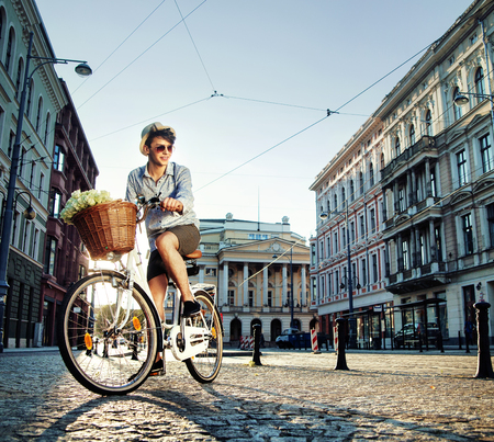 handsome boy: Young elegant man riding a bicycle Stock Photo