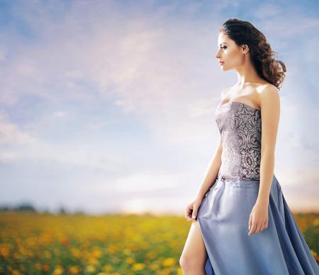 flower fields: Pretty woman on the summer wheat field Stock Photo