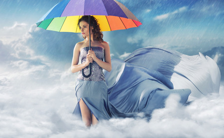 umbrella: Woman with a colorful wide umbrella Stock Photo