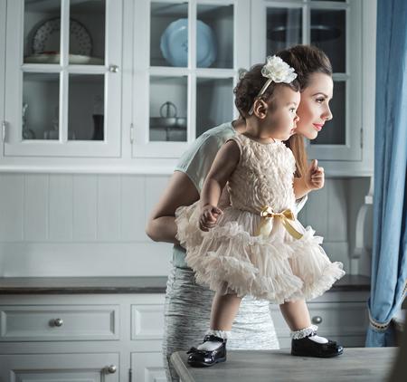 かなりママ素敵な赤ちゃんを抱いて 写真素材