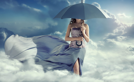 umbrella: Attractive lady walking on the clouds Stock Photo