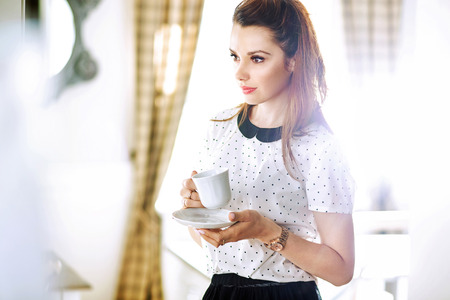 girl home: Pretty young woman drinking coffee