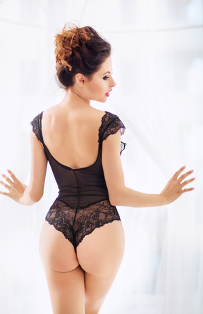 brunette naked: Brunette beautie wearing the lace lingerie Stock Photo