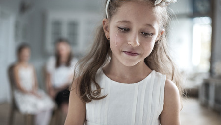 miserable: Portrait of a little miserable girl Stock Photo