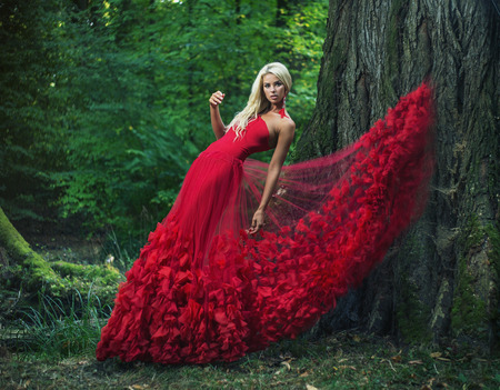 Beautiful woman wearing an amazing red dress photo