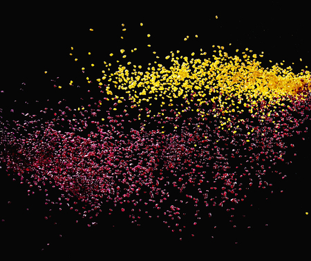 futuristic nature: Colorful tiny particles over a dark theme background